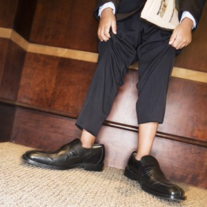 Boy Wearing Men's Dress Shoes and Suit --- Image by © Royalty-Free/Corbis